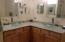 Glass bowls and granite counter tops in the bathrooms as well as lead free facets and a custom backsplash.