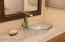Glass bowl sink and Granite counter top with lead free facet.