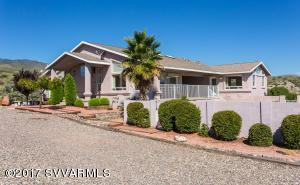 Large home with in-law quarters and level entry at both levels. Main level over 2800 sq ft light, bright, 16' vaulted ceilings, gourmet kitchen, swimming pool, hot tub, trees, mountain and red rock views. Bottom level over 1000 sq ft. Perfect for extended family. 2 Car attached garage plus a 1500 sq ft shop with power and setup for the car collector. A must see! Home is in need of some TLC. Mostly paint inside and out. Priced accordingly! Newer roof within the last few years. New well June 2017 and new AC unit just replaced. A lot of bang for the buck! Just too much home for one guy! Perfect home for a large family or someone who likes their space! Call for an appointment today!