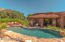 Outdoor kitchen & BBQ, sun shades, misters, TV ready & ample seating for outdoor entertainment.