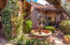 Private courtyard with fountain and lush vegetation.
