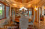 Formal Dining area with Custom-built beveled edge china cabinet.