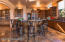 Breakfast Bar and socializing area opens directly into Great Room and spacious patio.