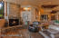 Separate sitting area in Great Room with gas fireplace and of course, red rock views.