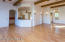 Combines dining and living in one Great Room