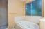 Jetted bathtub