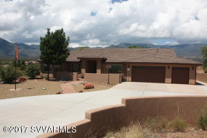 Remarkable views from every angle of this home!!  It's 3396 SqFt on 2 AC, built in 2004 in the foothills of Mingus Mt. just minutes from all amenities and from Sedona.  5BR, 4.25 BA PLUS an office and a game room allows for the entire family or for entertaining guests, and what a beautiful serene location to work from home.  Wood laminate floors with some carpet & tile.  Large kitchen with granite countertops & copper accents.  3 Bedroom suites with an attached bath plus a jack & jill bathroom for the remaining 2 bedrooms & a guest 1/2 Bath.  Split floor plan.  Master suite has a large walk in closet, jacuzzi tub, his & hers sinks, walk in shower and french doors opening to the back patio with gorgeous views of Mingus Mt.  2nd Bedroom has a jacuzzi tub and it's own private courtyard.