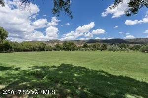 This 16.31 ac. (formerly) the Oak Creek Ranch School property has potential for another private School, B & B use or small retreat subject to approval by Yavapai County. Buyer to obtain a Use Permit.  Or ideal for a Family Estate or small horse ranch. Ten structures and improvements: a 4000+ Sq. Ft. administration building that could be turned into an amazing residence or other uses. Cabins and mobile homes used for residential or students dormitories and classrooms, library, science lab. Great horse training facilities with tack rooms and riding arena. Large pool multiple wells and grandfathered irrigation water. Enjoy full basketball and tennis courts, volleyball and skateboard park with outdoor lighting. Hiking and horseback riding on U.S. forest Service lands nearby.