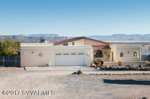 Amazing views of Mingus & Red Rocks from this spacious stucco home w/tile roof! Over 2722 sf ft w/ 4 lg bdrms & 3 baths in main house. PHuge 22 x 17 room off the garage - could be used as office (already has built-ins) or as in-law quarters.  Main house kitchen has center isle & granite counters! This house boasts decks from master bdrm & 2nd bdrm, also living rm & kitchen. All w/knockout views of Red Rocks. Enjoy the pool & guesthouse in backyard. Guest house(500 SF) has wood stove, full kitchen & bathroom. plus guest house of 500 SF Property has a workshop w/adjoining carport.  All this on over 1/2 acre!  This would make a fantastic FAMILY  home or....VERY POPULAR AIR B&B! Heating & cooling on right side of house runs on a Hydronic system (water). The left side is heated/cooled by gas pa