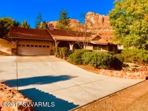Located on a large corner lot with circular driveway