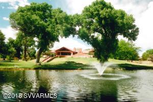 Magical & Glamorous setting and water front property with spectacular views. Fabulous 3500+ sq.ft. main residence on 11+ acres fronting on the Verde River. 2 ponds centered in very private & secluded property. 2 water fountains. Green lush irrigated pastures, gigantic trees and custom landscaping. This one of a kind super custom home boasts architectually designed great room - indoor/outdoor entertaining with floor to ceiling windows - chefs kitchen - Viking appliances - 500 bottle, temp controlled wine closet. 56'x100' open flagstone patio with fireplace overlooking the ponds and circular stage for your private concerts. Guest house - collectors 6 car garage - 4 stall barn with RV hookup - feed & tack room - large green irrigated pasture. (See supplement for more)