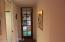 Doorway leads from kitchen to breezeway