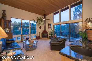 Cathedral Ceilings with Tongue and Groove Wood and wood burning fireplace. Take a look at those views...