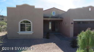 Located in gated Beaver Creek Preserve, with 101 custom home lots. This spacious 2074 sq foot home is the Stonebriar model. Construction completed with Certificate of Occupancy. BCP has a completed clubhouse, pool, tennis court, 1/3 mile nature walk, 42.0% in open space. Serviced by APS, AZ Water Company, fire hydrants, private roads, on-site sewer plant. Public Report is available. This price includes all lot premiums and numerous upgrades: Stainless steel appliances, kitchen granite countertops, range-oven, microwave and dishwasher; laundry room with sink, 8x18 insulated garage door for high profile vehicles, concrete roof tiles and post tension slab.