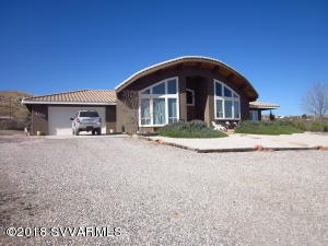 Custom built home nestled in the Mingus foothills with a 360-degree panoramic views of the beautiful Verde Valley. Inside you will find vaulted tongue & groove ceilings with exposed beams in the living, dining and kitchen areas. Awesome views from the living room & kitchen windows. Spacious kitchen for gatherings with abundant counter and cabinets. Master bedroom includes a walk-in closet, on suite bath with separate shower & jetted tub.  Office/den nestled behind arch window of dining area; two spacious bedrooms, laundry room.  Zoning allows for horses, farm, & domestic animals.  Plenty of property to start your own vineyard! Natural gas is available at the property line. This custom home is a must see to truly appreciate the possibilities.