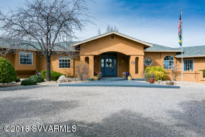Incredible executive home in move in ready condition.  FOREVER VIEWS, Red Rocks, Mingus Mountain, and the Verde Valley. Looking for privacy AND close to everything?  This is it!Spacious floor plan offers options!Need an in-law setup? Double Master suite area?  Fenced rear yard and electronic fencing in front protects your kids and critters. Enclosed garden for vegetables, herbs, or flowers. Double car garage, double car carport and plenty of room for your RV or boat.