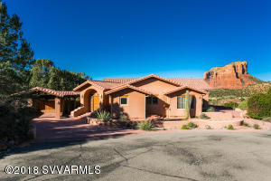 Beautiful, private, custom home on 3.09 acres with panoramic  unobstructed Red Rock VIEWS of Bell, Courthouse, Castle Rocks and Lee Mountain. Backs to Forest Service on East side of property which is accessed by it's own private gate. An equestrian lovers dream with lighted riding arena (sand and rubber mix overlayment), stables and hay barn. 3102 sq. ft. 3 Bdrm, 2 1/2 bath main home with detached three car garage with 508 sq. ft. fully furnished guesthouse.  Perimeter fencing in place. Gated subdivision.