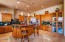 High ceilings, Cherry stained Alder wood cabinetry, coffee w/cream Travertine Stone floors, gorgeous Granite counter tops. Beautiful Display cabinets, maximum storage for all your cookware and serving dishware.
