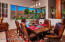This Dining Room can easily seat 8-12 family, friends and guests, with quick easy access to the covered patio and fire pit.