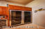 Double wide Stainless Steel Wine Cooler Temperature Controlled storage and Security Locking system. A smaller wine cooler is adjacent, these appliances are all contained in the convenient Butler's Pantry.