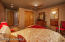 This is a different view of the Third Guest Suite and Bathroom. This suite has tinted windows and a ceiling fan.