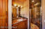 This Second Suite has a beautiful Slate Tile shower and lots of Alder wood cabinets and storage.
