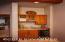 Media Room cabinetry, sink, beverage refrigerator, glass storage, Granite topped cabinet.