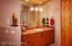 His & Hers separate vanities provide lots of cabinetry and storage space.