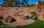 This back yard stacked stone fence provides privacy as well as a beauty, the double waterfall feature provides relaxing and soothing sound.