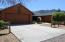 18 foot oversized garage door with concrete driveway and security lights.