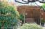 There are fruit trees, and, the swing with the pergola is included. Property features a tall enclosed fence.
