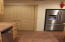 Kitchen has a pantry and built in space that is vented for the refrigerator. Refrigerator is not included.