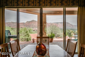 Custom Built in Sedona Golf Resort offering PANORAMIC RED ROCK VIEWS on one level featuring 2907 sq ft, 4 bdrm, 3 bth SPLIT Floorplan and 3 car garage. Great room w/ fireplace, kitchen & dining room boast picture windows to breathe in red rock views. Separated family room for media or reading. Gourmet Kitchen highlights corian counters, double ovens, gas cooktop, built in buffet, island, built in desk. SPACIOUS master retreat delights w/ views, enclosed camode, separate vanities, separate soaking tub and shower & walk in closet. Escape outside to the covered OUTDOOR LIVING ROOM for outdoor entertaining to marvel at the views or for star gazing. The pond brings solace after long excursions on the hiking trails & rounds of golf.This home is at the end of a beautiful paver drive.A MUST SEE!
