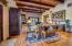 Elegantly rustic beams and tongue in groove wood ceilings.