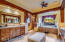 Notice the latilla accents on the cabinets(and other places in the home as well).