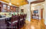 Wet bar adjacent to kitchen and Great Room! Perfect for entertaining!