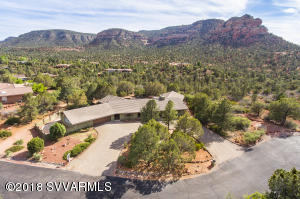 Your wait for the perfect retreat in Sedona is over!  This beautiful Highland Estates sanctuary offers 3 bedrooms each with their own on-suite bathroom and is surrounded by Red Rock views from every window, as well as every corner of the property.  From the inside open concept floor plan to the 4 outside sitting areas your breath will be taken way by the sweeping views.  But that is not all, the kitchen offers the Chef of the house two ovens to choose from (1 electric, 1 propane) as well as every cupboard has pull out features that are one of a kind.  Schedule your showing today as you really need to experience the flow of positive enery this home offers; complete with a medicine wheel.