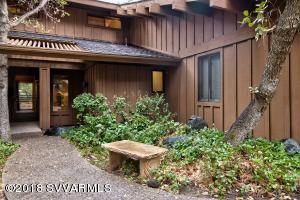 One of the only homes with no stairs into entry... ease, privacy and nature.