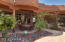Enjoy outdoor dining on this shaded patio convenient to outdoor grill and indoor kitchen.