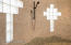 double walk in shower with river rock floor and tumbled marble floor to ceiling surround.
