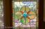 Stained glass window in kitchen.