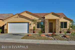 This listing is the SALES MODEL, seller request up to 2 year leaseback and will pay $2400 month plus HOA dues, taxes & insurance.  EnergyStar certified home with w/post tension foundation featuring open, split floor plan.  Tile floors & carpeted bedrooms. bonus room(approx 20'x12 ft) pre-plumbed for future bathroom. Located in the foothills of Mingus Mountain w/distant Sedona RR views. Kitchen have extended knotty alder cabinets, an extended island and granite counter top w/breakfast bar & walk-in Pantry.  Master bath features double granite vanity, full tile shower and walk-in custom built in closet. 3-car tandem garage with built in cabinets & work bench and epoxy floor in garage.  Covered patio.  Livrm with built-in ent ctr & elec fireplace.