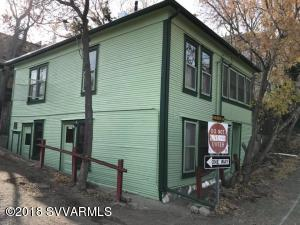 Historic Home in Jerome -- remodeled in 2016, this old Miner's Abode has been restored back to its original beauty of 1912 by owner. Check out ''Its NOT Okay House of Healing'' facebook page to view the construction -- work was done to the recommendation of an engineer and with permits. According to the 1917 map, this home - with 5 bedrooms and 2 full baths -- was listed as lodging for miners. It is thought that the home housed 15 men, one per bedroom per shift.  Today the bedrooms have been converted to living rooms; however, they can still be bedrooms.  The Little House (salvage) in the back is believed to be the original owners' home since it is the only structure which would allow for just one family. The remodel included: tearing out the foundation, digging new cornerstones, pouring c