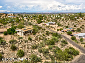 This 3.11 acre parcel allows you to spread out with tons of privacy!  Room for all your vehicles, equipment, animals, etc.  The home sits on a bluff overlooking beautiful views of the valley. Recent remodel includes new kitchen counter tops, fixtures, carpet, bathroom updates, paint, electrical, plumbing, and low-E windows! The original wood flooring and amazing stone work throughout the home adds to the home's character and charm. 3 beds and 2 baths on the main level with a wrap around deck. 1 bed w/bath and large living area downstairs can be accessed from inside or outside.  Extra large garage has room for at least 4 vehicles plus has power and water for easy conversion to guest house. Click for more.