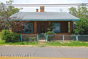 2 Units!  Endless possibilities for this super charming craftsman home.  Currently set up as a separate upstairs and downstairs home, both with full kitchens and bathrooms, but could also be used as a single home, with an interior stairwell connecting both units. Upstairs is a 1110 sqft spacious 1 bedroom with 2 closets and a bonus den or office, also features a huge living room, dining room, built-ins, wood burning brick fireplace, and a nice bathroom accessible from both the bedroom and the living space, 10 foot ceilings, plus excellent views, and a spacious covered and private front porch.  Downstairs is a 1110 sqft, 2 bedroom, 1 bathroom with a large and open kitchen, and 2 separate front rooms.  It features a private wood deck facing toward the rear of the property, with amazing views