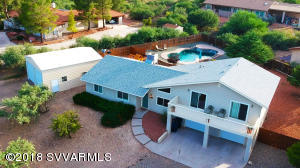 This 3 bedroom + den home is in an ideal location, Jerome, Clarkdale's Historic Main Street, Verde Canyon Railroad and the Wine Tasting rooms of Old Town Cottonwood are all just minutes away. NEW Carpet, recently installed new windows/doors, well pump, roof and more! The large lot has plenty of room for parking and a detached garage for storage or an RV. The large backyard features a pool and plenty of room for play. Inside the den/office can be used as a fourth bedroom. The split level has an additional family room and large master suite with a deck where you can enjoy endless views of the Verde Valley and Sedona in the distance. Downstairs the garage has plenty of room for storage and tools. This is a 3 bedroom plus den/office which is currently being used as a 4th bedroom. No HOA.
