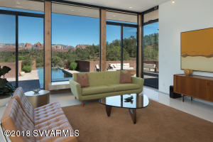 UNBLOCKABLE RED ROCK VIEWS with incredible glass walls facing Red Rock State Park, taking in the view of Cathedral Rock.  This Mid Century Modern home has the newest, high end amenities.  The Design Group created a spacious, open flow with surprising design elements to treat the eye and lend surprising functionality.  Gourmet kitchen with Miele appliances. Solar with an average bill of $25!  A solar heated saltwater lap pool is the crown jewel of the large patio.  Modern berm in a natural setting...STUNNING!