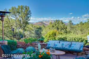 Welcome to 145 Cathedral Rock Trail offering 3/4 acres, main house and separate guest house with multiple patios for entertaining or for taking in nature.