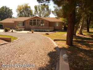 A rare opportunity to own property in this highly desired Green belt neighborhood on a .45 acre lot with beautiful lush landscaping and irrigated by Cottonwood flood ditch. With redwood and Trex decking front and back,relax in the shade of the old growth Cottonwood and Sycamore trees and with an outdoor kitchen to appreciate the beauty you are surrounded by.The split floor plan with 3 bedrooms/2 baths has bay windows and skylights to appreciate the natural light. Exposed beam, high vaulted ceiling with a wood burning stove in the great room,polished granite counter tops, bamboo ceilings ,beautifully tiled bathrooms, an enclosed AZ. room with bamboo ceilings