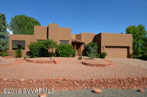 Amazing Red Rock  views of Sugarloaf & Coffee Pot,  within a block of the Sugarloaf Loop trailhead.  Enjoy a gourmet kitchen with island, bar counter, natural gas cook top, wall oven with microwave.  Dining room & living room have large windows to take in the red rock views, doors to open & covered patios to sit & enjoy the Sedona sunsets.  Master-suite has 2 walk-in closets,  Jacuzzi tub & separate tile shower.  Over sized 2 car garage...the list goes on and on. Be sure to check out our video walk-through.